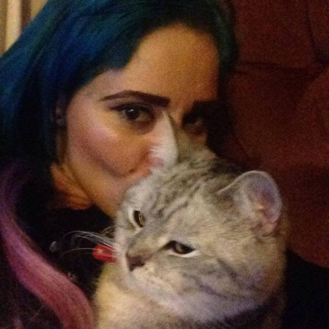 A photo that Denise took of herself and her cat, Enzo.