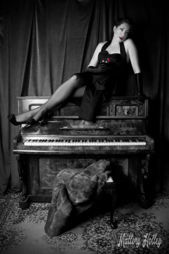 Pinup beauty Miss Kylie on vintage piano