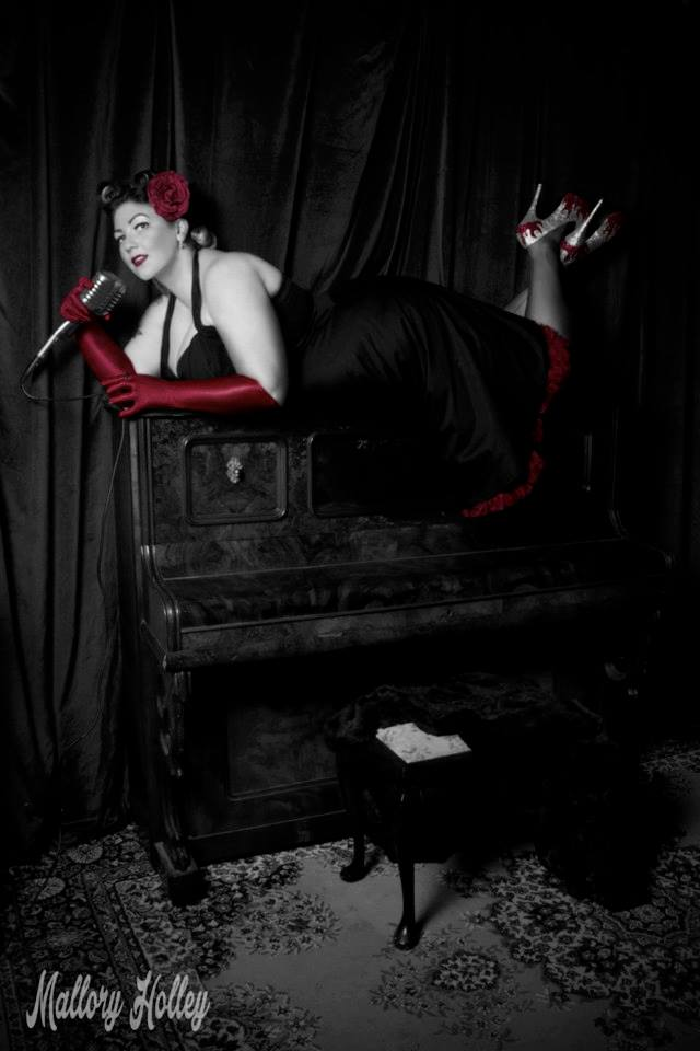 Pinup beauty Miss Laura on antique piano