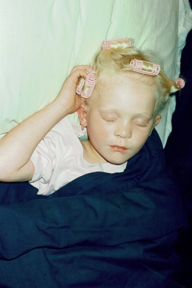 Sleeping with pink curlers in my hair when I was little -photo courtesy of my Mum