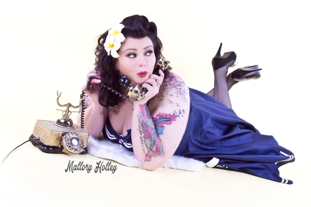 Pinup photoshoot with telephone and motley Hell Bunny dress