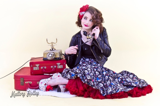 Pinup portrait with telephone and suitcases